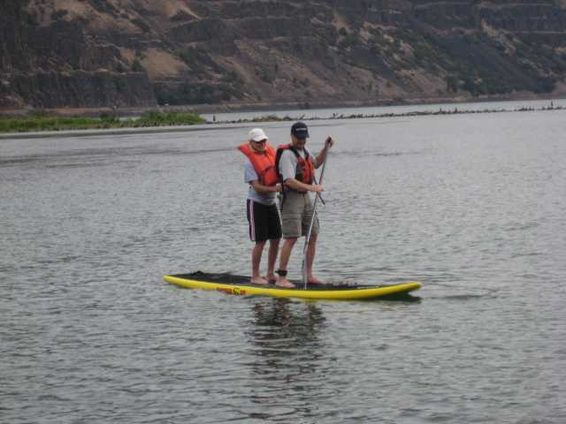 Tandem Standup surfboard riding